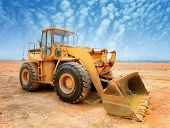 stock photo of earth-mover  - bulldozer on a building site - JPG