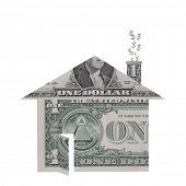 A house shape made from dollar bills with dollar signs rising from chimney symbolizing the housing c