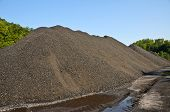 image of nonrenewable  - A Large Stock Pile of Coal on the Ground - JPG