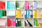 stock photo of differences  - White office shelves with different stationery - JPG
