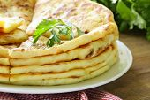 picture of flat-bread  - pile of fried bread with butter and parsley - JPG
