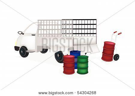 Hand Truck Loading Oil Barrels Into Pickup Truck