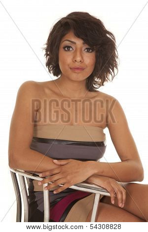 Hispanic Woman Close Sitting In A Dress Serious