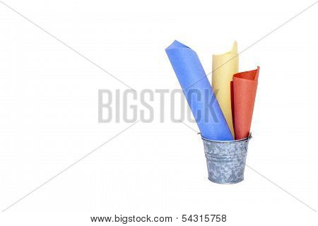 Galvanised Bucket Containing Three Rolled Colored Papers