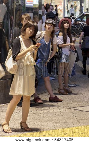 Fashionable Japanese Women Standing In The Street