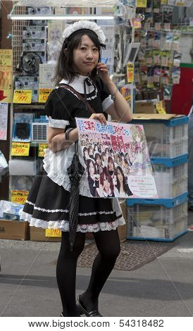 A Girl Advertising Cosplay Hostess Bar In Tokyo