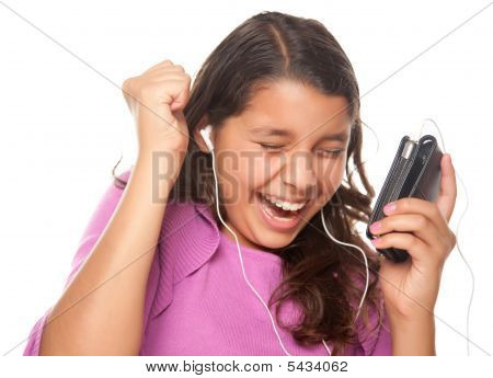 Pretty Hispanic Girl Listening And Dancing To Music