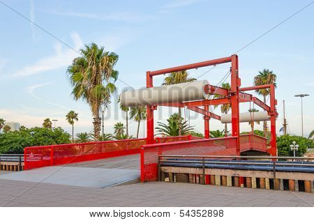 Barcelona, Spain - Bridge for pedestrians on Passeig de Colom, a wide avenue lined with palm trees