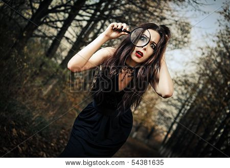Strange Scared Goth Girl Looks Through Loupe