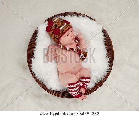 Newborn Baby Wearing A Gingerbread Girl Hat