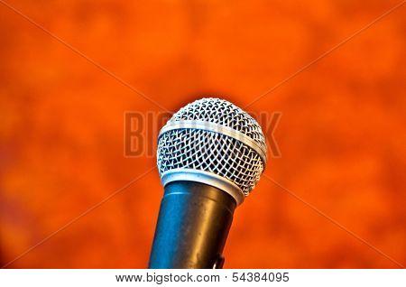 Black microphone on an orange background