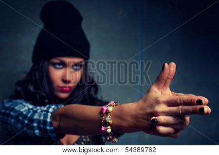 Young woman hand sign.