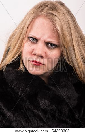 Sour And Stubborn Young Woman In A Fur Jacket