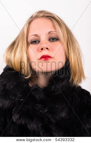 Saucy Young Attractive Woman In A Black Fur