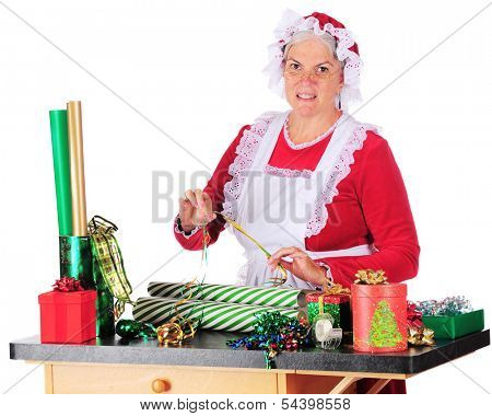 Mrs. Claus trying to decide which ribbon to put use with which wrapping paper as she wraps Christmas gifts.  On a white background.