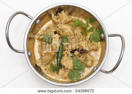 Homemade balti chicken pasanda, made with spices, yoghurt, cream and chopped coriander and chillies seen from above in a kadai ( karahi or wok) serving bowl, garnished with cilantro and a green chilli