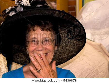 Elderly Woman Laughing Wearing Hat