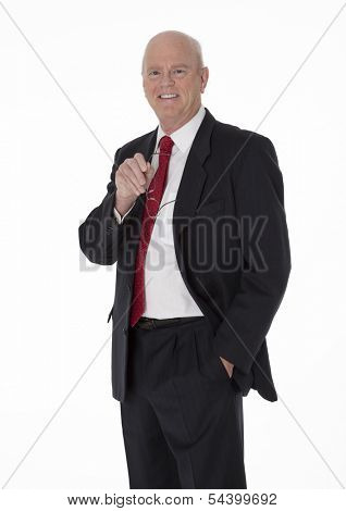 Balding cheerful mature businessman dressed in black business suit standing on white background