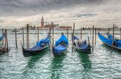 pic of gondola  - Venetian gondolas on water in cloudy weather HDR - JPG