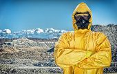 pic of biological hazard  - Worker in protective chemical suit over mountains - JPG