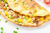stock photo of fried onion  - Omelet with diced vegetables on a plate - JPG