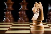 stock photo of wood pieces  - photo of white knight chess on chessboard for game - JPG