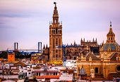 stock photo of mary  - Giralda Spire Bell Tower Seville Cathedra Cathedral of Saint Mary of the See Church of El Salvador Seville Andalusia Spain - JPG