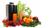 pic of juicer  - A Juicer surrounded by healthy fruits and vegetables - JPG