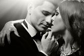 stock photo of seduce  - Sensual dark portrait of cute sexy young couple - JPG