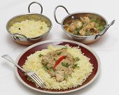 stock photo of kadai  - High angle view of balti chicken pasanda curry served on a bed of saffron rice - JPG