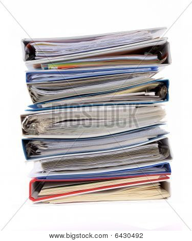 Multicolored Stack Of Binders With Papers