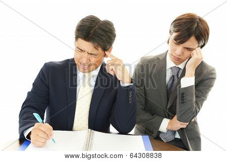Disappointed Asian businessmen