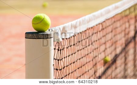 Tennis Balls On The Court Near Tennis Nets
