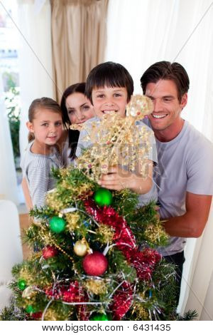 Happy Family Decorating A Christmas Tree