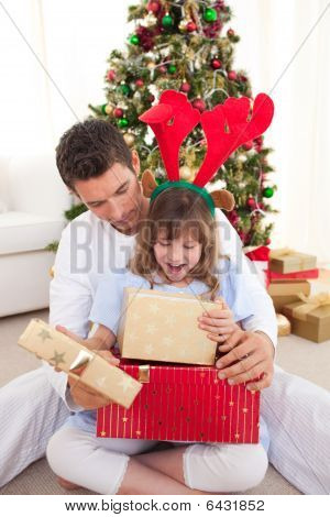 Happy Father And His Daughter Opening Christmas Gifts