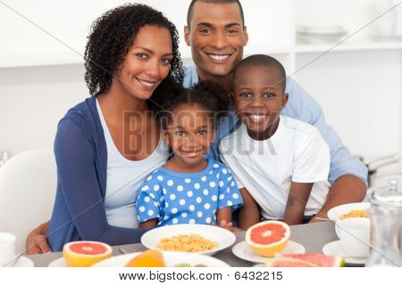 Happy Family Having Healthy Breakfast