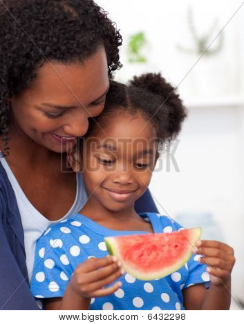 Beautiful Girl Eating Watermelon With Her Mother