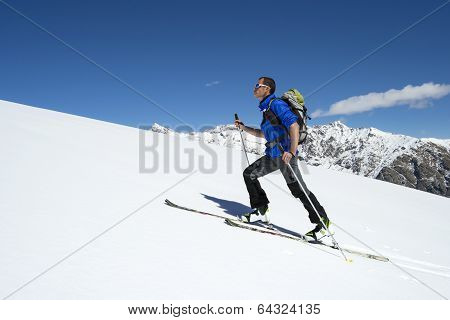 Skier ascending to the top