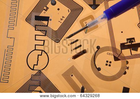 RFID tags and implantation syringe