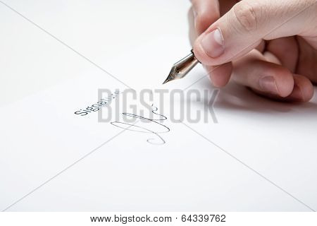 Pen In The Man's Hand And Signature