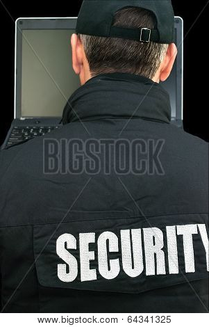 Security Working On Laptop, Over The Shoulder