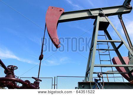 Crude Oil  Jack Pump Under Blue Sky In Europe