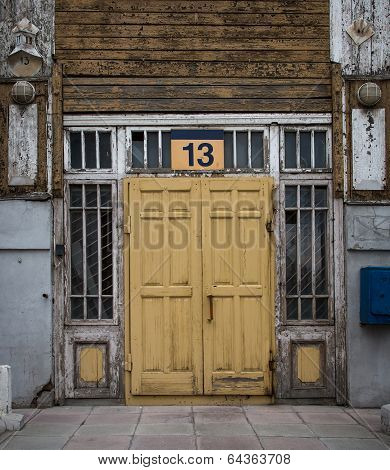 Old, Yellow, Wooden Door With The Number 13.