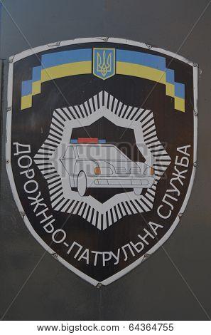 KIEV, UKRAINE - APR 30, 2014:Ukrainian Road Police chevron painted on the gate of Police Department .April 30, 2014 Kiev, Ukraine