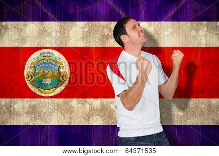Cheering football fan in white against costa rica flag in grunge effect