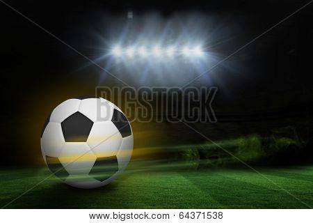Football against football pitch under spotlights