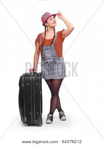 Young hitchhiker going on vacation with her suitcase.