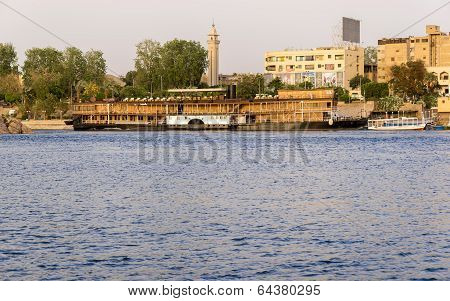 Nile River by Aswan City skyline with Boats