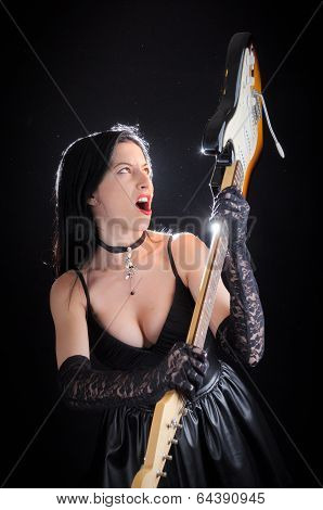 Goth Woman Swinging Electric Guitar