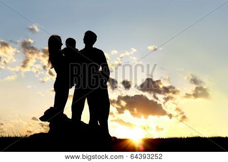 Happy Young Family And Dog Silhouette At Sunset
